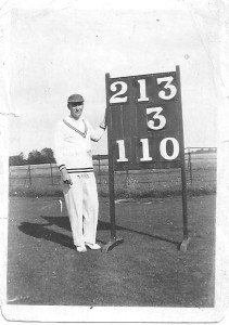 John Evans with cricket scoreboard (click to view larger photo